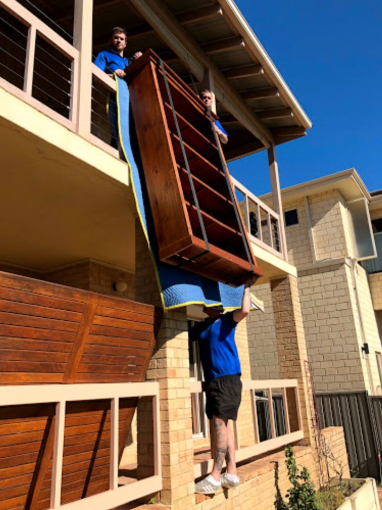 Moving antique furniture over a balcony